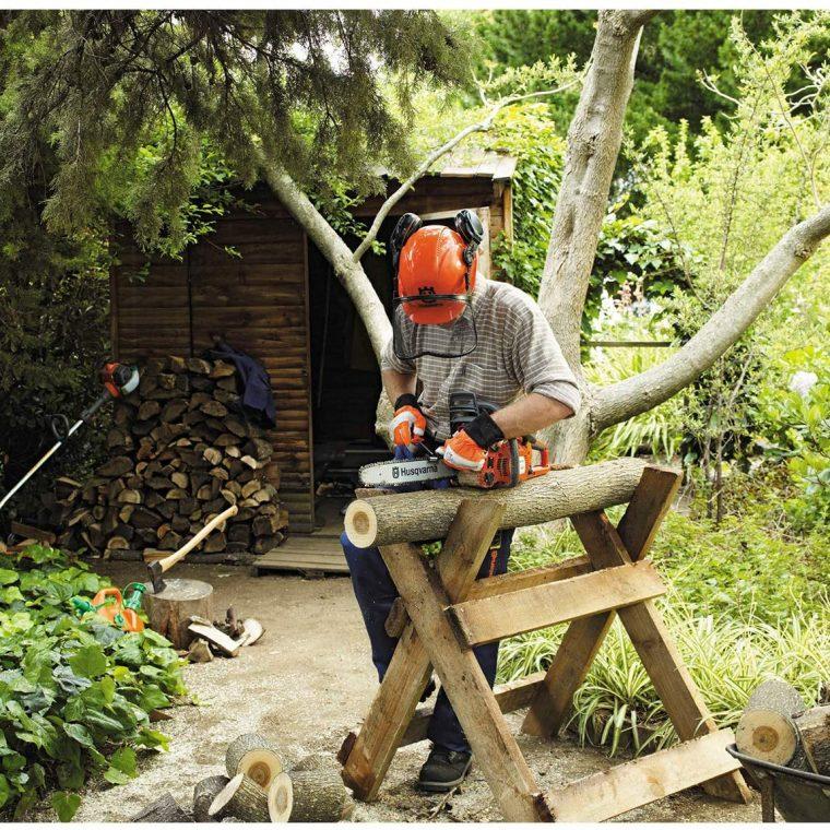 Man using Chainsaw to cut tree